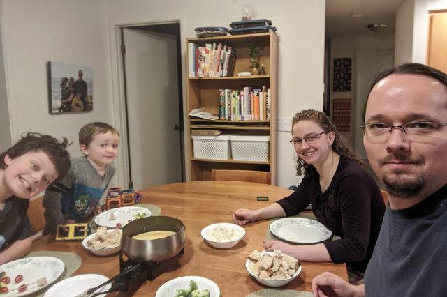 Calvin, Julian, Kiesa, and Jaeger sit down to fondue for the solstice