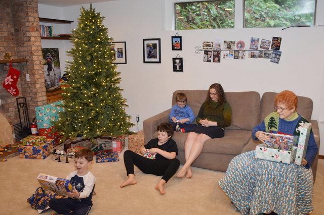 Caleb, Calvin, and Julian open Christmas presents