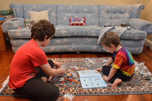 Calvin and Julian play with Christmas Legos
