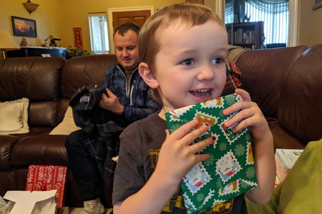 Julian opens a present