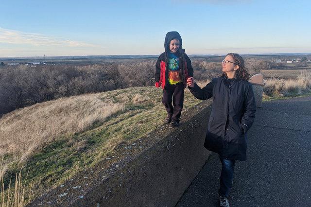 Julian walks on the wall at Whitman Mission with Kiesa