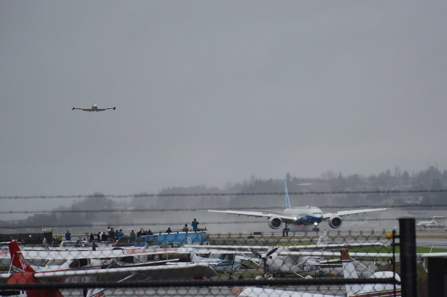 Chase plane flies above 777X first flight N779XW at Boeing Field