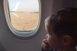 Julian looks out the window of an Alaska 737-900 at ONT