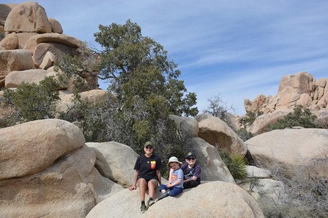 Sharon, Julian, and Calvin on a rock outside Hidden Valley