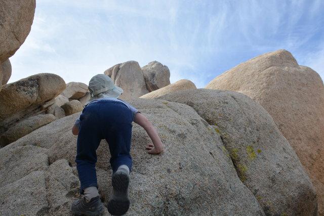 Julian scrambles up a boulder