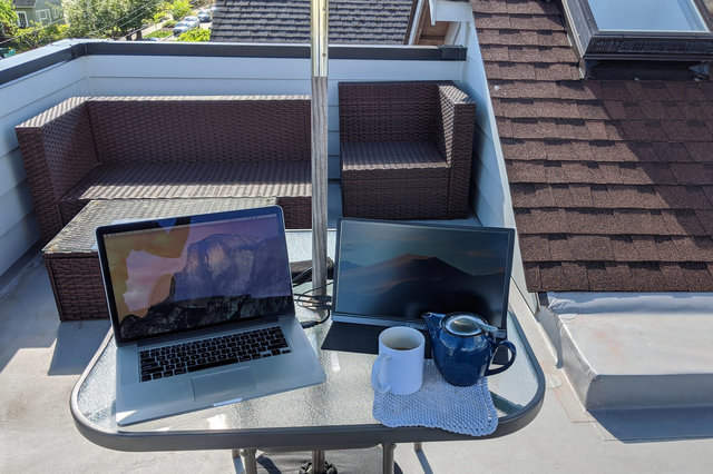 Macbook and portable monitor on roof
