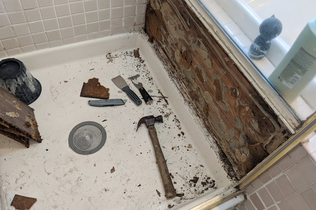 Rusted shower panel removed
