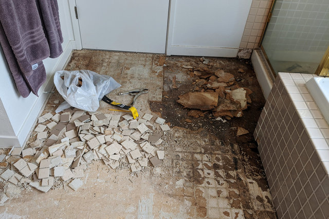 Tile and underlayment removed in master bath