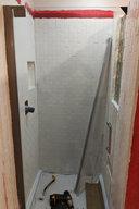 Shower door half-installed