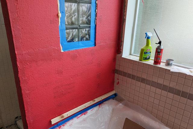 Outside shower wall prepared for tile