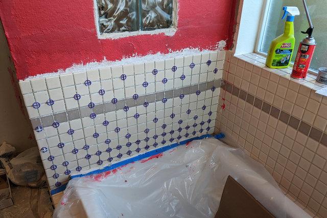 Tile installed above tub