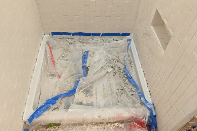 Short tiles installed at bottom of shower