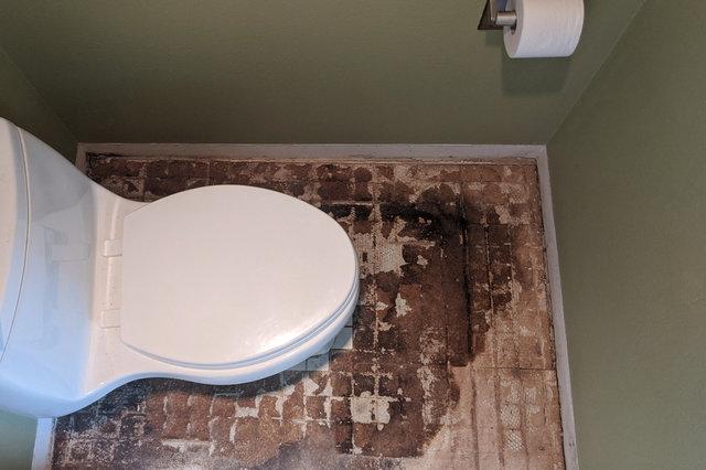 Water-damaged floor around toilet