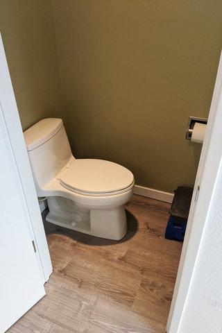 Toilet installed over new floor