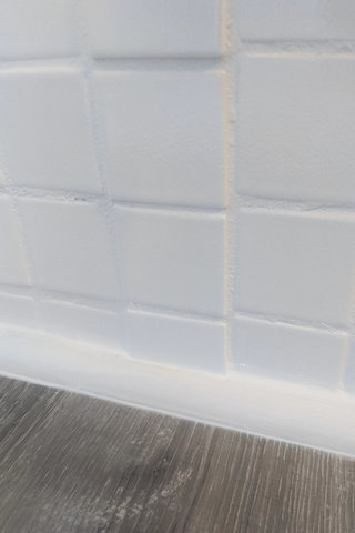Notch cut around protruding tile