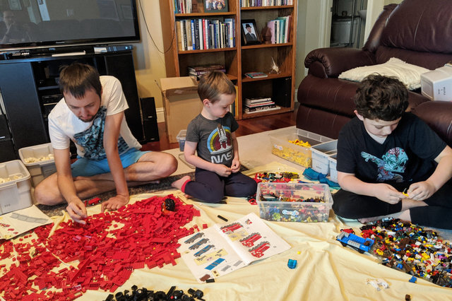 Uncle Willy, Julian, and Calvin build Lego