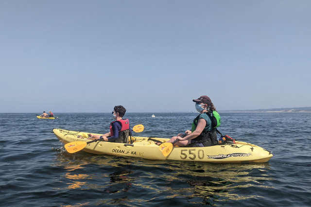 Calvin and Kiesa kayak on Monterey Bay