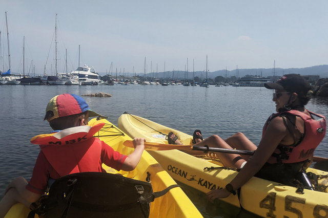 Julian and Sharon on kayaks in Monterey Harbor