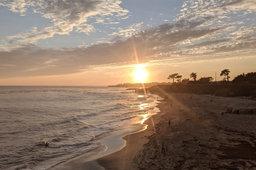 Sun sets over Lighthouse Point Beach