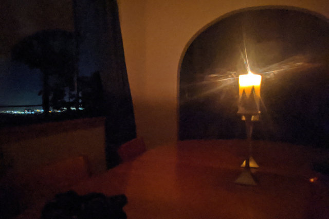 Dining table lit by candlelight