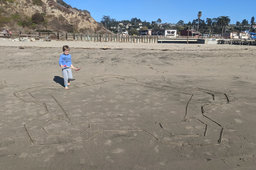 Julian surveys the outline of a sand star fort
