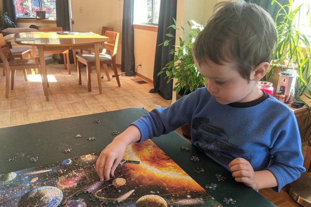 Julian helps assemble a space puzzle