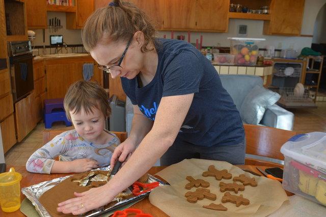 Julian helps Kiesa cut gingerbread people