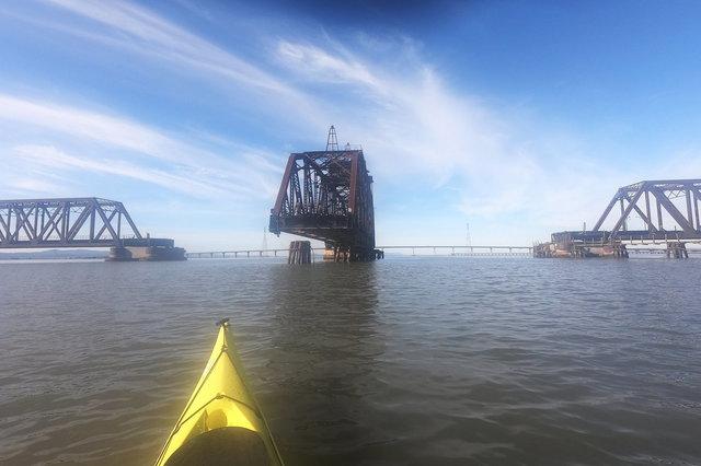 Kayak approaches the open Dumbarton Rail Bridge