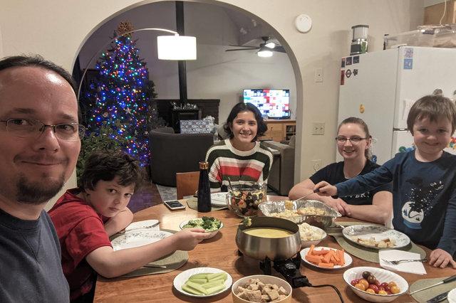 Jaeger, Calvin, Sharon, Kiesa, and Julian sit down to cheese fondue