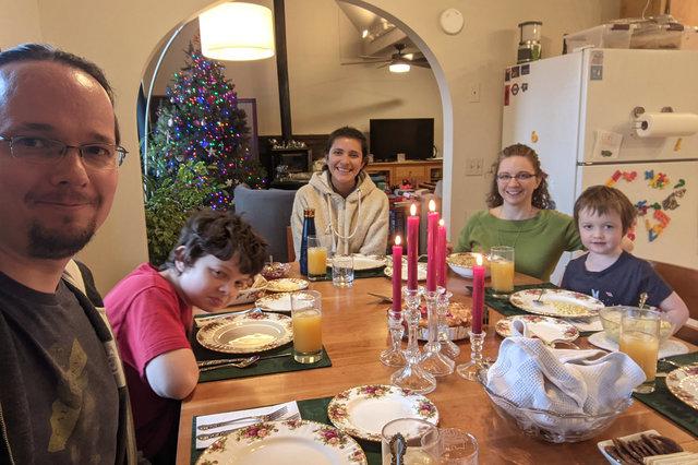 Jaeger, Calvin, Sharon, Kiesa, and Julian sit down to Christmas dinner