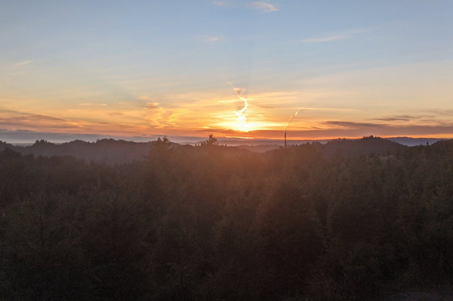 Sun setting over Summit Tree Farm