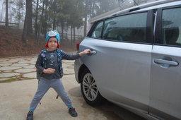 Julian gets into the car for kindergarten