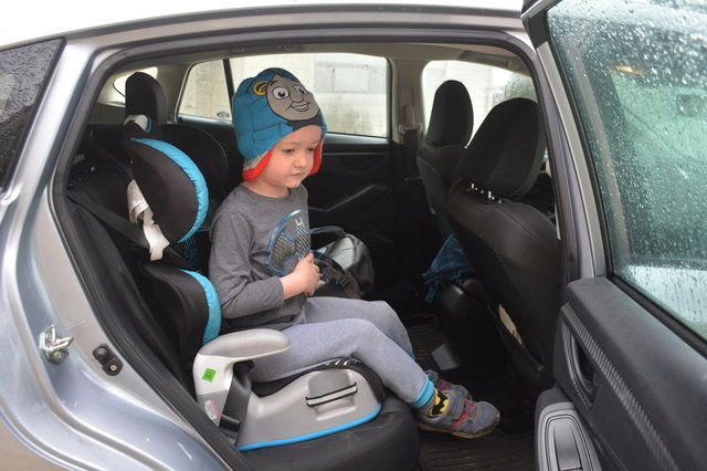 Julian in the car ready to go to kindergaten