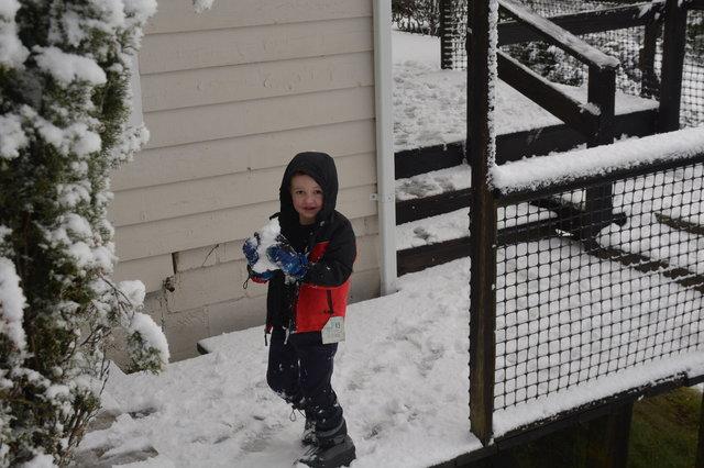 Julian carries a snowball