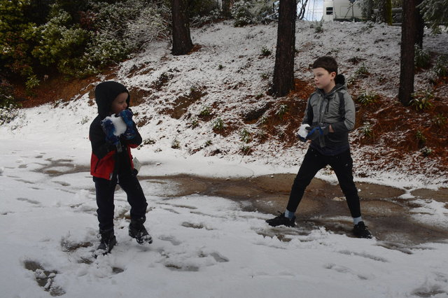 Julian and Calvin face off in a snowball fight