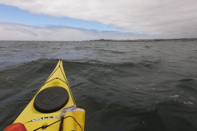 Kayaking past Santa Cruz anchorage