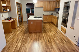 Refinished wood floors in the kitchen at Nanna Ct