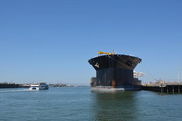 SF Bay Ferry Scorpio cruises past USNS John Glenn in Oakland