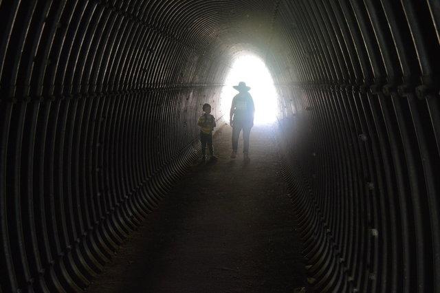 Julian and Kiesa walk through the tunnel under I-80