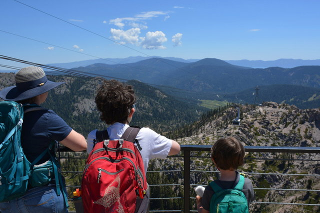 Kiesa, Calvin, and Julian watch the tram descend from Squaw Valley