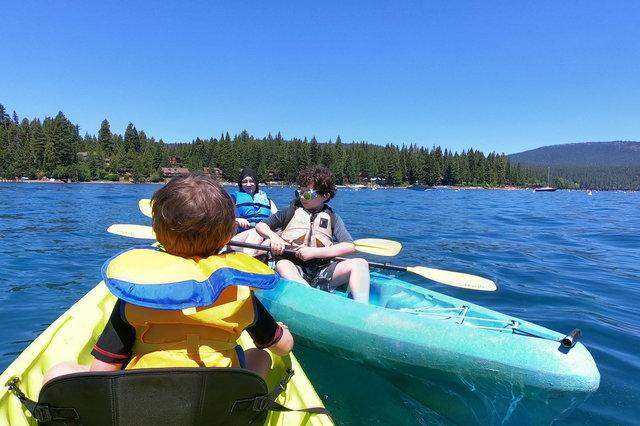 Julian, Kiesa, and Calvin kayak on Lake Tahoe