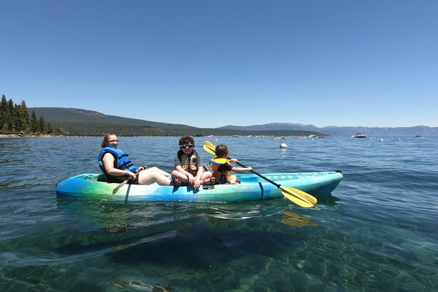 Kiesa, Calvin, and Julian in a kayak on Lake Tahoe