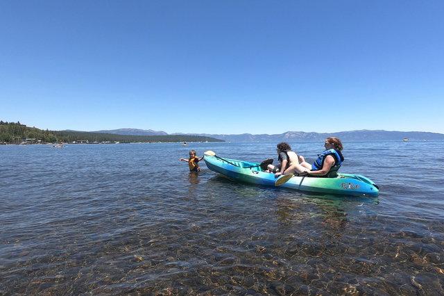 Julian pulls Calvin and Kiesa in a kayak