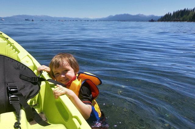 Julian attempts to reenter a kayak