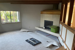 Carpet install in progress in the living room