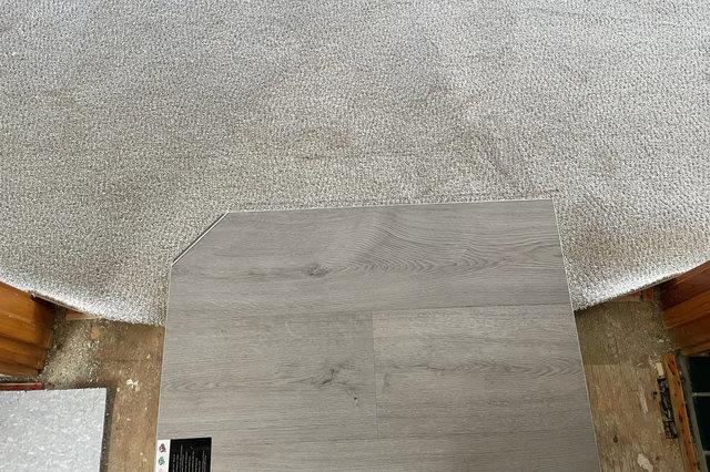 Checking floor sample against carpet