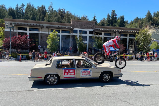 Stunt bike hops off sedan