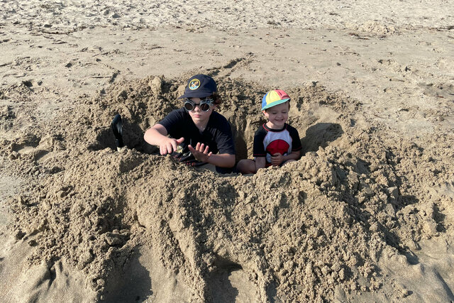 Calvin and Julian in a foxhole on Four Mile Beach