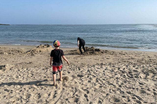 Julian walks towards Calvin's foxhole on Four Mile Beach