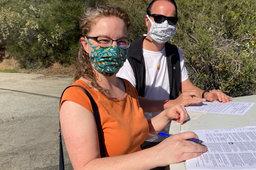 Kiesa and Jaeger signing mortgage papers on Loma Prieta Way